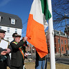 Peabody:<br /> From left, Jack Lawless, president of the Ancient Order of the Hibernians,Division 11, and Bill Mahoney, Massachusetts State Organizer, help raise the Irish flag is in front of city hall.<br /> Photo by Ken Yuszkus/Salem News, Wednesday, March 17, 2010.