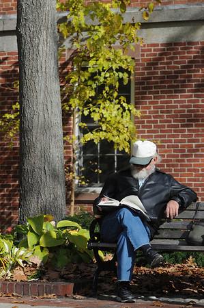 Salem:<br /> Ken Piotrowski, of Salem, sits on a bench reading a book in the warm midday sunshine at the pedestrian mall in Salem on Thursday.<br /> Photo by Ken Yuszkus/Salem News, Thursday, November 3, 2011.