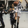 Peabody:<br /> Peabody's Katie Brunelle goes for a shot at the basket during the Peabody vs St. Raphael's Academy in the the girls final of the Tanner City Holiday Basketball Tournament at the Peabody Veterans Memorial High School fieldhouse. <br /> Photo by Ken Yuszkus/Salem News, Wednesday,  December 29, 2010.