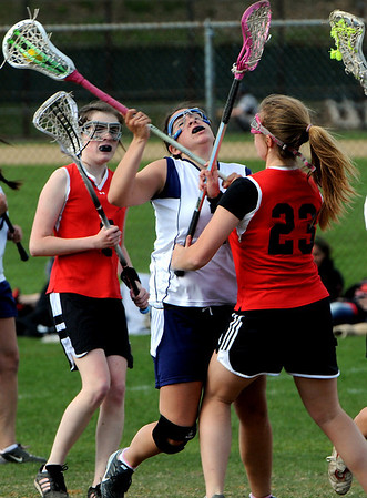 Peabody:<br /> Peabody's Nicole Napolitano, left, collides with Salem's Jess King during the Salem at Peabody girls lacrosse game.<br /> Photo by Ken Yuszkus/Salem News, Friday, April 30, 2010.