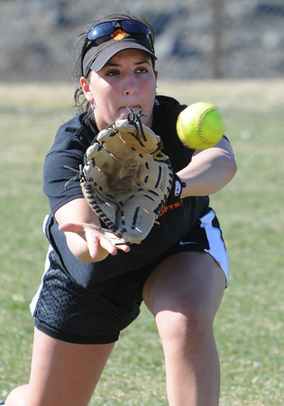 Beverly:<br /> Aliki Kallas, one of the captains, during Beverly High softball practice at Innocenti Field.<br /> Photo by Ken Yuszkus/Salem News, Tuesday, April 3, 2012.