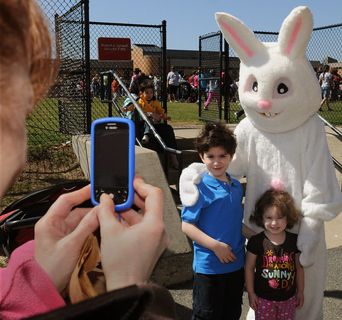 Salem:<br /> Hilda DaSilva takes a photo of her children, Elijah and Aerial, all of Salem, with the Easter bunny during the Mayor's annual Easter Eggstravaganza on the Bowditch School grounds<br /> Photo by Ken Yuszkus/Salem News, Saturday, April 3, 2010.
