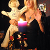 Salem:<br /> Lorelei conducts a ceremony at her Crow Haven Corner business to raise energy to help Tom Brady. She is holding a Tom Brady stuffed doll during part of the ceremony.<br /> Photo by Ken Yuszkus/Salem News, Friday, January 13, 2012.