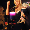 Salem:<br /> Lorelei conducts a ceremony at her Crow Haven Corner business to raise energy to help Tom Brady. She is holding her dog Chico during part of the ceremony.<br /> Photo by Ken Yuszkus/Salem News, Friday, January 13, 2012.