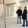 Swampscott:<br /> Steve Hayes and his wife Lisa in the family room of the second floor in their Phillips Beach Fire Station which is now being transformed into their home. The fire pole is in the foreground on the left.<br /> Photo by Ken Yuszkus/Salem News, Tuesday,  November 30, 2010.