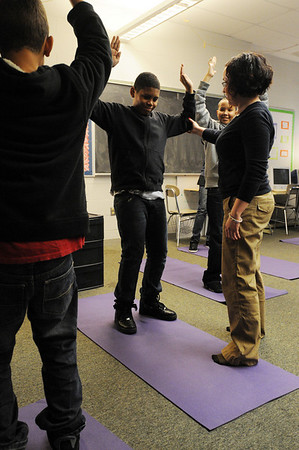 Salem:<br /> James Lora, center, is helped by Sarah Mason. He along with other Collins Middle School students in Sarah Mason's Learning Skills Classroom do yoga led by Sarah Mason.<br /> Photo by Ken Yuszkus/Salem,  News, Monday,  December 20, 2010.