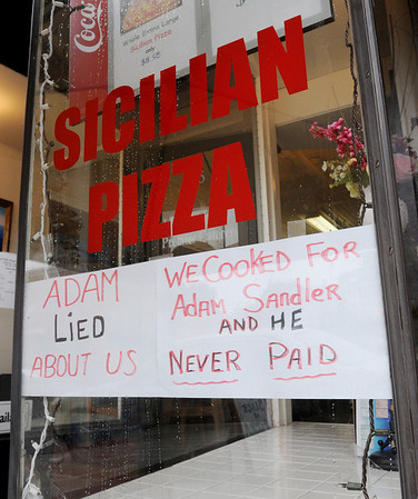 Peabody:<br /> A sign in the window at Little Italy Cafe.<br /> Photo by Ken Yuszkus/Salem News, Monday, August 15, 2011.