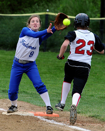 Marblehead:<br /> Danvers' Chrissy Gikas, left, gets the throw to first base as Marblehead's Olivia Vener arrives safe at the Danvers at Marblehead softball game.<br /> Photo by Ken Yuszkus/Salem News, Monday, May 23, 2011.