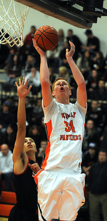 Beverly:<br /> Beverly's Zach Zigelbaum goes up for a shot at the basket as Salem's Emilio Beato follows during the Salem at Beverly boys basketball game.<br /> Photo by Ken Yuszkus/Salem News, Tuesday, January 3, 2011.