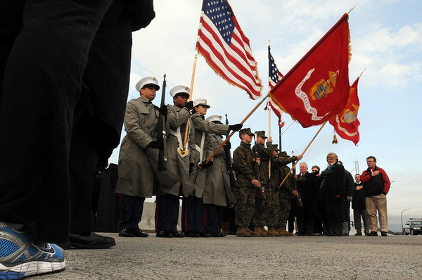 "Salem/Beverly:<br />  The national anthem is played at the start of the ""Bridging the Gap"" ceremony at the middle of the Veterans Memorial bridge where Beverly and Salem met Monday morning. <br /> Photo by Ken Yuszkus/Salem News,  Monday,  November 22, 2010."