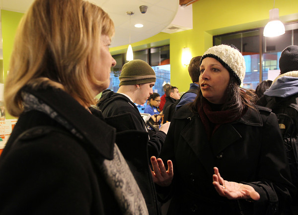 Salem: Salem Mayor Kim Driscoll, right, talks with State Senator Joan Lovely, left, inside Orange Leaf on Derby St. on Friday afternoon. Driscoll and Lovely attended the launch party for the Community PlanIt Game for the Point neighborhood. David Le/Salem News
