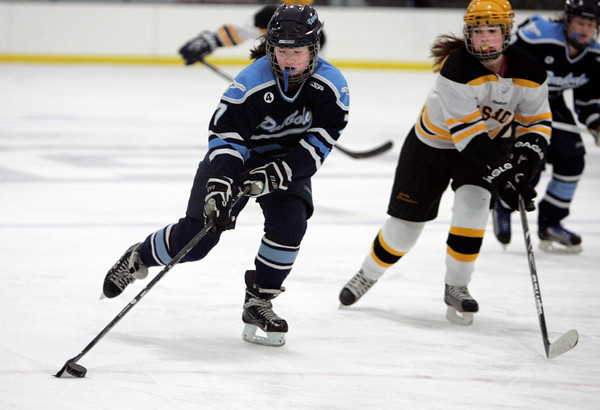 Peabody:<br /> Peabody's Sophia Post, left, brings the puck down toward the goal with Bishop Fenwick's Nina Groom at her side during the Bishop Fenwick vs. Peabody girls hockey game at McVann-O'Keefe Rink.<br /> Photo by Ken Yuszkus/The Salem News, Wednesday, January 23, 2013.