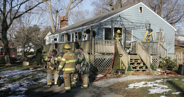 Wenham:<br /> A morning fire damaged this house at 94 Main Street in Wenham.<br /> Photo by Ken Yuszkus/The Salem News, Thursday, January 10, 2013.