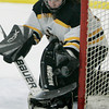 Peabody:<br /> Bishop Fenwick's goalie Meghan Woodworth makes a save as the puck is deflected off her stick during the Bishop Fenwick vs. Peabody girls hockey game at McVann-O'Keefe Rink.<br /> Photo by Ken Yuszkus/The Salem News, Wednesday, January 23, 2013.