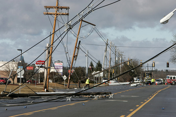 Peabody:<br /> The fallen and tilting utility poles on Route 114.<br /> Photo by Ken Yuszkus/The Salem News, Thursday, January 31, 2013.