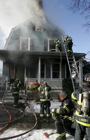 Swampscott:<br /> The scene of the fire at the front of 50 Andrew Road in Swampscott.<br /> Photo by Ken Yuszkus/The Salem News, Thursday, January 3, 2013.