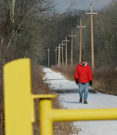 Wenham:<br /> Newly retired Stan Doron of Danvers usually walks about five miles on the railtrail.<br /> Photo by Ken Yuszkus/The Salem News, Monday, January 7, 2013.