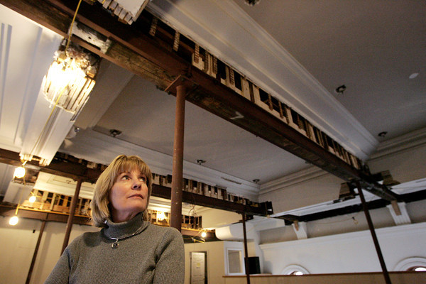 Peabody:<br /> Peabody Institute Library director Martha Holden stands under the beam which broke and was repaired along with the strengthening and shoring up of the other beams on the 3rd floor of the historic section of the library on Main Street in Peabody.<br /> Photo by Ken Yuszkus/The Salem News, Monday, January 28, 2013.