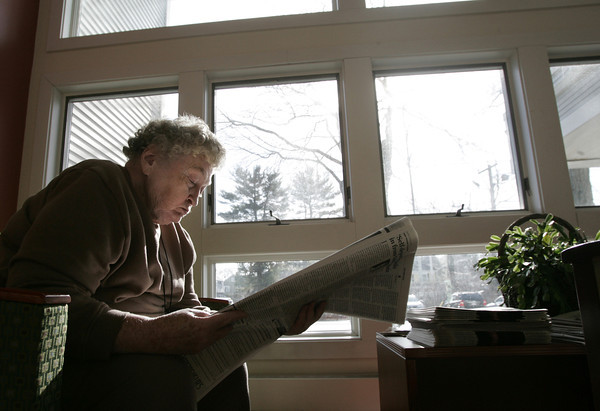 Beverly:<br /> Jessie Dronsfield of Beverly reads in the warm sunlight at the Beverly Council on Aging Senior Community Center. The last few days were good days to stay inside away from the cold temperatures and strong winds. <br /> Photo by Ken Yuszkus/The Salem News, Friday, January 25, 2013.