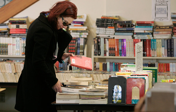 Salem:<br /> Patricia O'Flynn searches through a table of books at the Salem Public Library.<br /> Photo by Ken Yuszkus/The Salem News, Friday, January 11, 2013.
