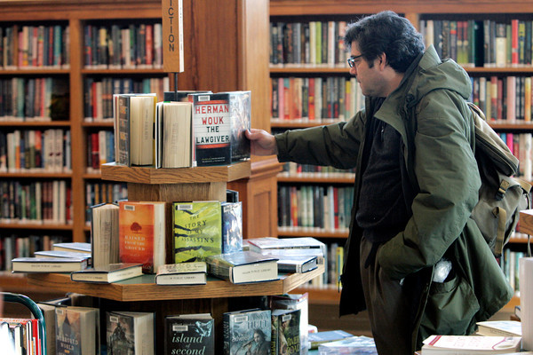 Salem:<br /> Max Burbank looks over some of the books on display at the Salem Public Library.<br /> Photo by Ken Yuszkus/The Salem News, Friday, January 11, 2013.