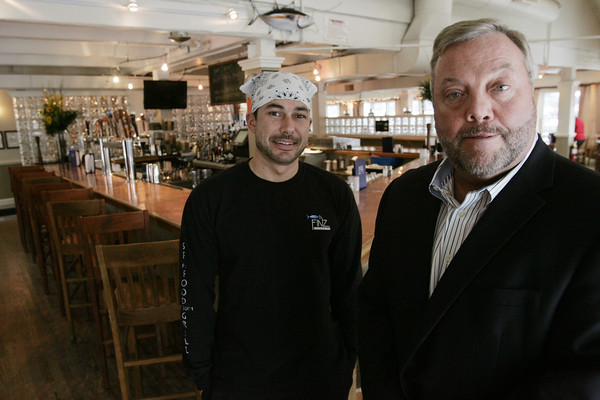 Salem:<br /> Serie Keezer, left, executive chef, and George Carey, owner, at Finz Seafood and Grill Restaurant in Salem.<br /> Photo by Ken Yuszkus/The Salem News, Tuesday, January 29, 2013.