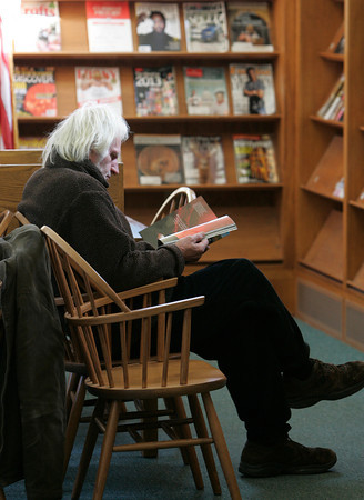 Salem:<br /> Franklyn West reads a magaine while seated at the Salem Public Library.<br /> Photo by Ken Yuszkus/The Salem News, Friday, January 11, 2013.