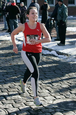 Salem:<br /> Taylor Krajewski of Salem is the first female to cross the finish line in the 6th annual Wicked Frosty Four Road Race.<br /> Photo by Ken Yuszkus/The Salem News, Tuesday, January 1, 2013.