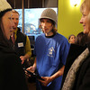 Salem: Mayor Kim Driscoll, left, and State Senator Joan Lovely, right, talk with Adam Delonais, 20, from North Shore CDC, at a launch party for the Point Neighborhood video game at Orange Leaf on Friday afternoon. David Le/Salem News