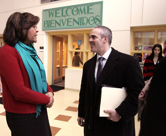 Salem:<br /> Education Secretary Matt Malone, right, is greeted by principal Victoria Shams, left, as she welcomes him to the Bowditch School. He later spoke about education funding relative to Gateway Cities and toured the school.<br /> Photo by Ken Yuszkus/The Salem News, Wednesday, January 30, 2013.