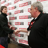 Beverly:<br /> Kenny Pierce, left, of the Beverly football team shakes hands with Paul Millman who is the acting store manager of Modell's Sporting Goods store.<br /> Photo by Ken Yuszkus/The Salem News, Friday, January 18, 2013.