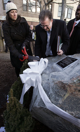 Salem:<br /> Mayor Kim Driscoll and Scott Weisberg, Salem No Place for Hate chairman, cut the ribbon at the dedication program of a new memorial in downtown Salem. Local officials joined Salem No Place for Hate Committee at the new memorial.<br /> Photo by Ken Yuszkus/The Salem News, Thursday, January 31, 2013.