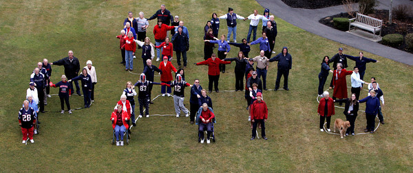 """Peabody:<br /> Residents and employees at Brooksby Village are wearing red white and blue and forming the words """"Go Pats"""" outside behind the clubhouse for a photograph.<br /> Photo by Ken Yuszkus/Salem News Tuesday, January 15, 2013."""