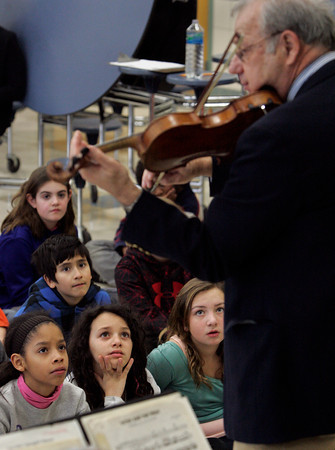 Beverly:<br /> Front row from left, Dariangelys Colon, Arianna Marchese, and Nicole Reusch, with David O'Brien and Hannah Costa in back, listen to Alan Hawryluk play the violin during the Cape Ann Symphony presentation to introduce the orchestra and instruments to the 4th and 5th grades at the Cove School .<br /> Photo by Ken Yuszkus/The Salem News, Tuesday, January 29, 2013.