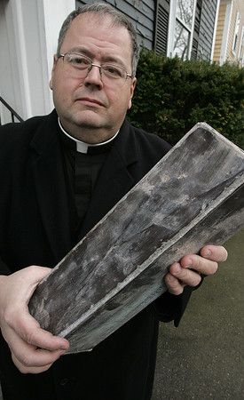 Salem:<br /> Rev. John Sherian holds the time capsule found at the St. Joseph Church demolition site.<br /> Photo by Ken Yuszkus/The Salem News, Tuesday, January 15, 2013.