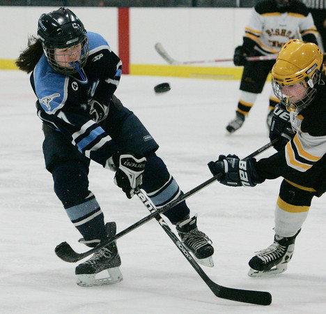 Peabody:<br /> Peabody's Sophia Post, left, and Bishop Fenwick's Nina Groom make the puck fly during the Bishop Fenwick vs. Peabody girls hockey game at McVann-O'Keefe Rink.<br /> Photo by Ken Yuszkus/The Salem News, Wednesday, January 23, 2013.