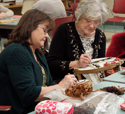 Peabody:<br /> Andrea Gendron, left, and Betty Travers work on their rug hooking projects at the Peter A. Torigian Community Life Center. They belong to the group called the Peabody Council on Aging Hookers.<br /> Photo by Ken Yuszkus/The Salem News, Wednesday, January 30, 2013.