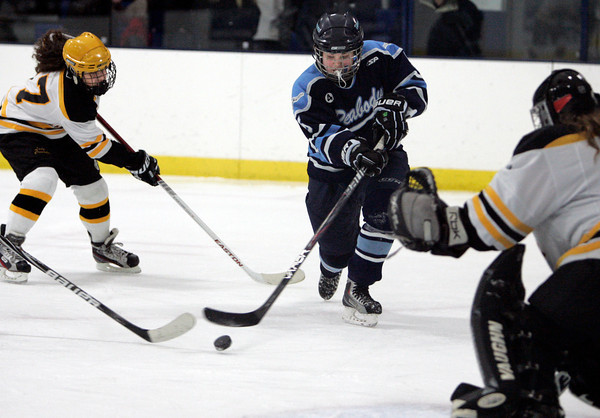 Peabody:<br /> Peabody's Laura Miele shoots for the goal with Bishop Fenwick's Alex Pagano, left, coming up from behind during the Bishop Fenwick vs. Peabody girls hockey game at McVann-O'Keefe Rink.<br /> Photo by Ken Yuszkus/The Salem News, Wednesday, January 23, 2013.