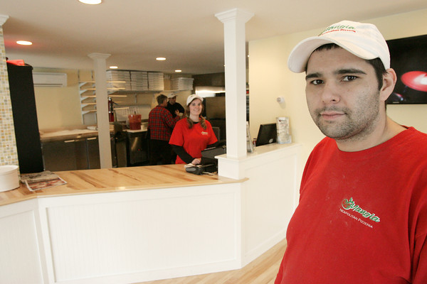 Wenham:<br /> Anthony Triantafillou is the manager of the new Mangia Pizzeria in Wenham.<br /> Photo by Ken Yuszkus/The Salem News, Thursday, January 17, 2013.