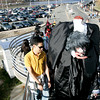 Salem: A head less man walks up the steps at the MBTA Station to enjoy Halloween in Salem. Photo by Mark Lorenz/Salem News