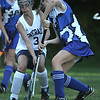 Hamilton: Hamilton-Wenham's Grace Farnan tries to block Georgetown High School's Shannon Killian near Hamilton-Wenhams goal. Photo by Mark Lorenz/Salem New