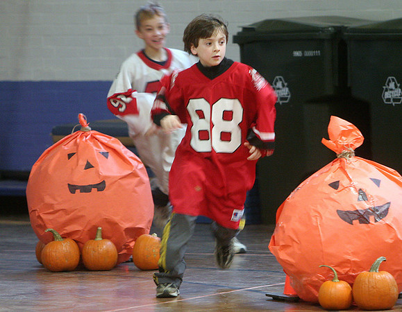 Salem: Quinn Galante-Barrett chases Thomas Philbin through part of an obstacle course, during Saltonstall School annual Stew Day. Students took part in crafts, art, and plenty of food. Photo by Mark Lorenz/Salem News
