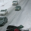 Beverly: A car spins out on Route 128 at exit 19 in Beverly, during yesterdays storm. Photo by Mark Lorenz/Salem News