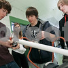 Salem: Jacob Spector, tapes one end of this tube, with the help of his partners, Haily Lyons, Mack Ryan and Kevin Roberts, during the Salem High School Science expo. Their project was an air gun, that would shoot a ball at the speed of light. Photo by Mark Lorenz/Salem News