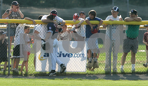 Bristol: Peabody West's Matt Hosman is hugged by fans in the outfield, after connecting for a grand -slam by in the bottom of the 6th inning, giving Peabody a 11-7 victory over Rhode Island in the New England Finals, giving them a trip to Williamsport. Photo by Mark Lorenz/Salem News