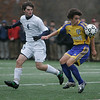 Danvers: St. John's Prep James O'Leary looks to defend Acton-Boxborough's Ryan Rose in the first half of play. Photo by Mark Lorenz/Salem News
