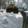 Salem: City workers remove snow on Essex Street, in preparation for more snow coming that, is expected today and Wednesday. Photo by Mark Lorenz/Salem News