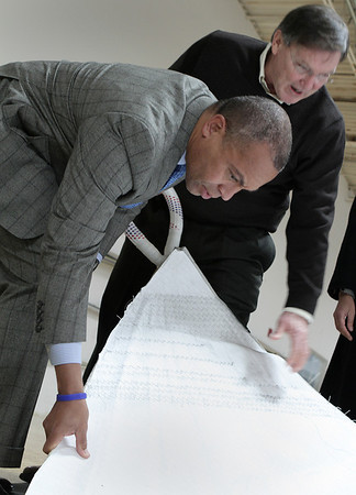 Salem; Robbie Doyle, president of Doyle Sailmakers, Inc. explains some materials to Governor Deval Patrick during a tour of the business in Salem. photo by Mark Lorenz/Salem News