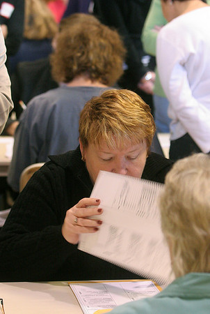 Peabody: Karen McCafferty, counts ballots from the Ward 4 council race, during a recount at Peabody City Hall, Saturday morning. photo by Mark Lorenz/Salem News