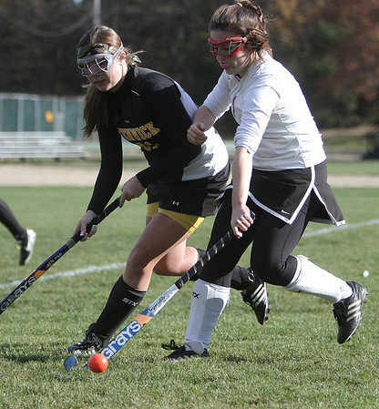 Marblehead: Bishop Fenwick's Lauren Campbell and Marblehead's Caroline McCarthy battle for the ball in North Division II Tournament.  Photo by Mark Lorenz/Salem News